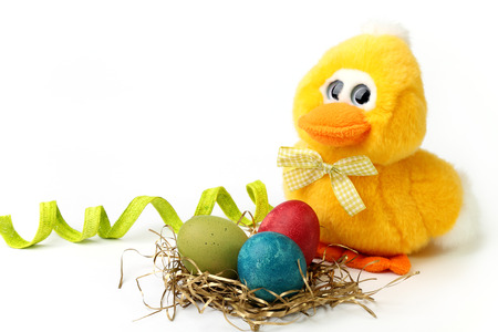 Plush chick and Easter eggs