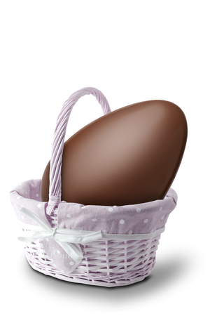 Chocolate egg in a basket