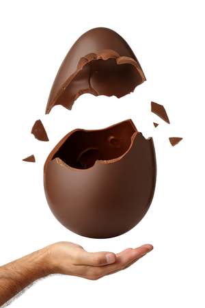 Easter egg exploded onto the palm of your hand Standard-Bild