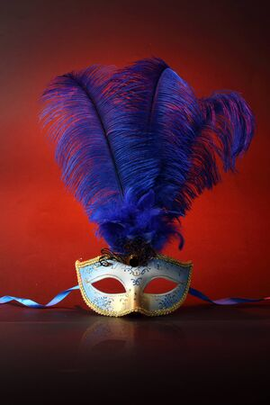 Beautiful masks on wooden table