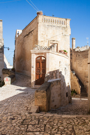 Old street among houses of Sassi or stones of Matera European capital of culture 2019, Basilicata, Italy, vertical