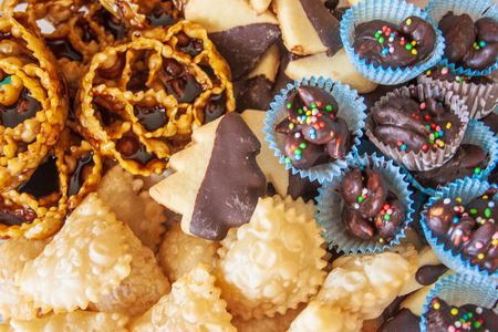 Traditional Christmas home made sweets, cartellate, pastries filled with figs syrup, chocolate and butter biscuits, almond sweets, Bari, Puglia, Italy