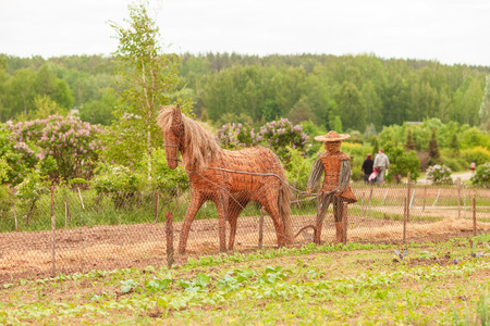 Straw horse, garden sculpture in a farm in Lithuania with straw farmer