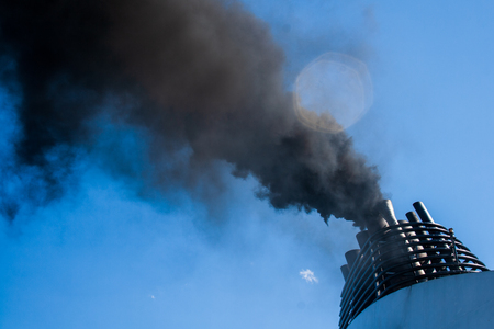 Ships funnel emitting black smoke, air pollution