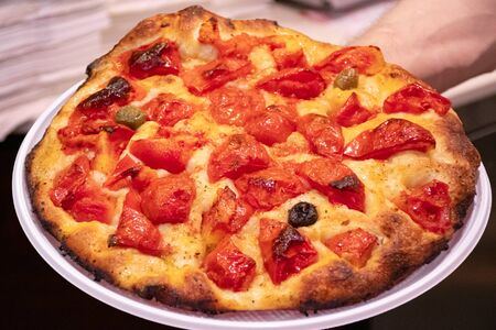 Focaccia, typical traditional food of Bari, Puglia, Italy, baked tasty hot bread with tomatoes and olive