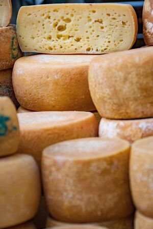 Variety homemade bio natural cheese in a street food market, vertical