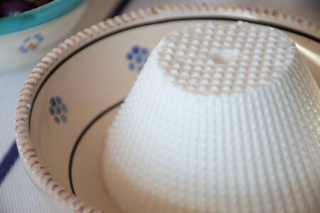Fresh Ricotta, Italian whey cheese made from sheep, cow, goat, or Italian water buffalo milk whey left over from the production of other cheeses in a terracotta traditional pot