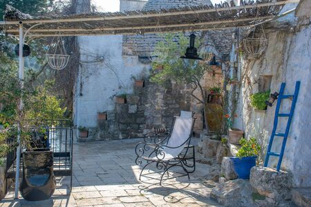 Relaxing veranda in a traditional old country house in Puglia, Italy, Europe