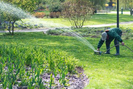 Girl with an automatic irrigation system equipment garden watering tool Reklamní fotografie