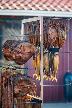 Dried smoked spiced mackerel fresh fish in a fish market, vertical Imagens