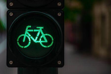 Sustainable transport. Bicycle traffic signal, green light, road bike, free bike zone or area, bike friendly Archivio Fotografico