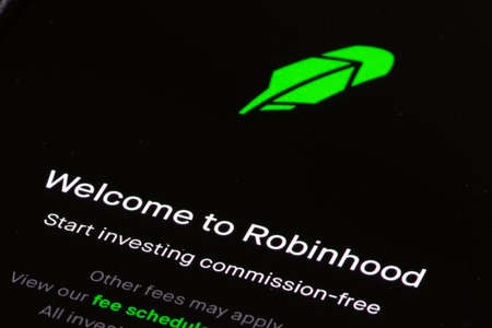 Vilnius, Lithuania - February 3 2021: Robinhood app and logo on the screen of a smartphone. American financial services company. Commission-free investing in stocks