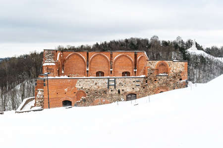 Part of Gediminas Tower or Castle, the remaining part of the Upper Medieval Castle in Vilnius, Lithuania with three crosses hill in winter day with snow Stock fotó