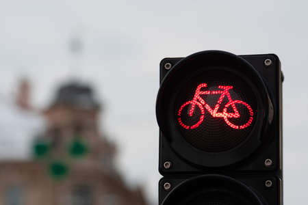 Sustainable transport. Bicycle traffic signal, red light, stop sign, road bike, free bike zone or area, bike sharing, close up