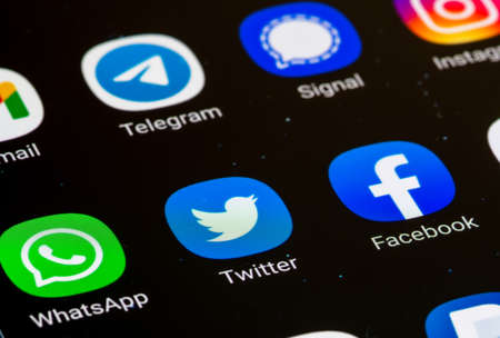 Vilnius, Lithuania - February 23 2021: Facebook, Twitter, Whatsapp app displayed together on a smartphone. Social media app. Social network