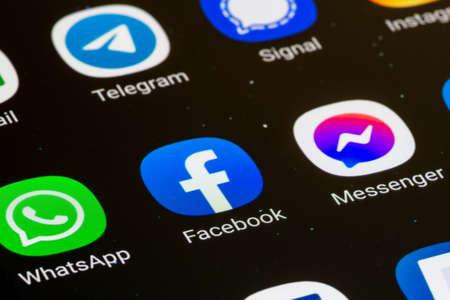 Vilnius, Lithuania - February 23 2021: Facebook, Messenger, Whatsapp app displayed together on a smartphone. Social media app. Social network
