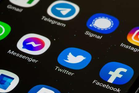 Vilnius, Lithuania - February 23 2021: Facebook, Messenger, Twitter app displayed together on a smartphone. Social media app. Social network