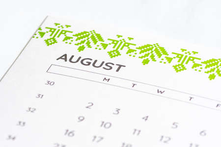 Month of August 2020 on the calendar on a white table with days, close up