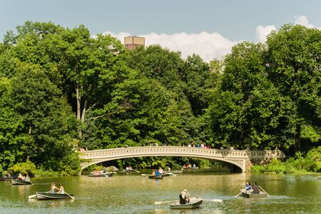 A sunny day at the lake in Central Park - New York - Usa Stock Photo - 128350512