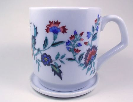 a decorated cup and saucer