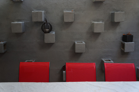 red wall: Red Chairs Against Grey Stone wall