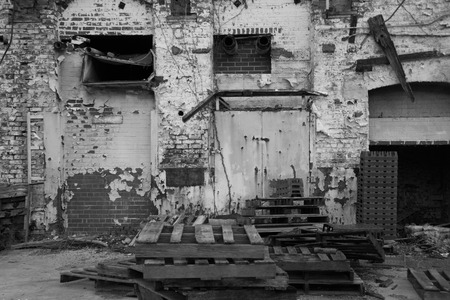 abandoned warehouse: Abandoned warehouse exterior in back and white Stock Photo