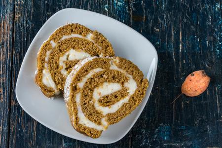 rum cake: Sliced Pumpkin Rum Cake Roll on White Plate