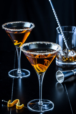 cocktail mixer: Spiced Citrus Martinis on Black Background Stock Photo