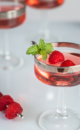 Raspberry Cordials in a Coupe Stock Photo
