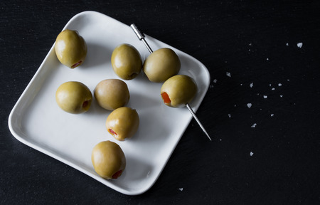 desired: olossal Spanish Queen Olives on cocktail picks with space for text if desired