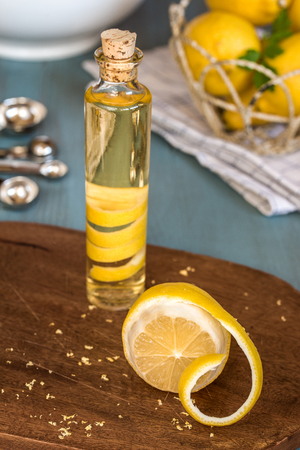 infusing: Homemade lemon extract made by infusing lemon peel in vodka