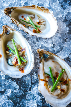 beau: Beau Soleil Oysters with Chives and Pepper Flakes on Ice