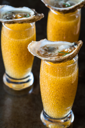 Mango Chia Rum Shooters with Oysters Banco de Imagens - 66404273