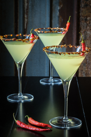 Chili Pepper Martinis with Tin Background Banco de Imagens