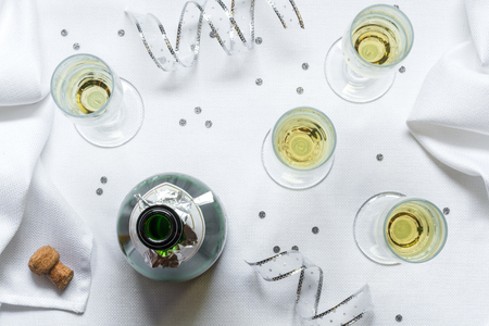 flutes: Uncorked bottle of bubbly with champagne flutes