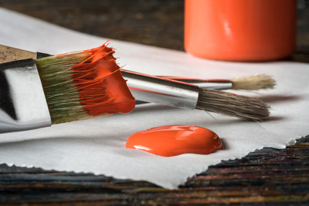 Artists Paintbrushes with Red Orange Paint