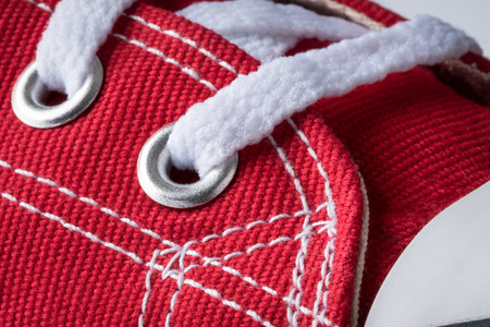 Red tennis Shoe lace eyelet Stock Photo
