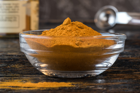 Ground Turmeric Root in an ingredient bowl Banco de Imagens