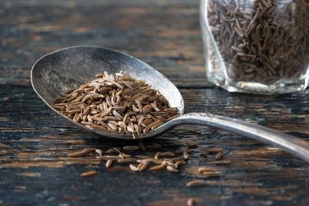 A vintage spoon of caraway seeds