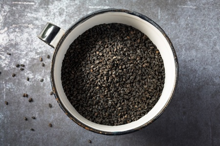 A cup of black sesame seeds