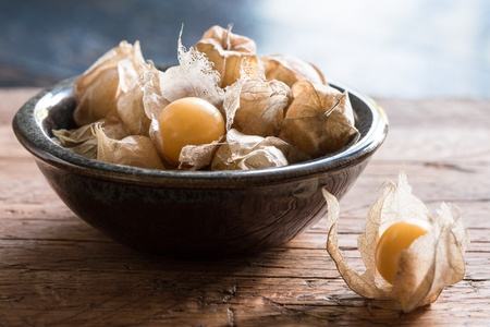 A bowl of ground cherries Stock Photo
