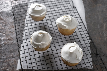 Vanilla cupcakes with whipped topping