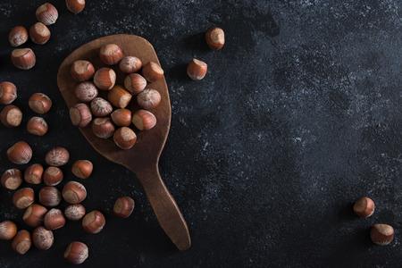 Hazelnuts on a Wood Paddle