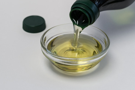 Pouring Olive Oil into an ingredient bowl 写真素材