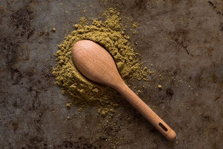Ground Cumin and Wood Measuring Spoon Zdjęcie Seryjne