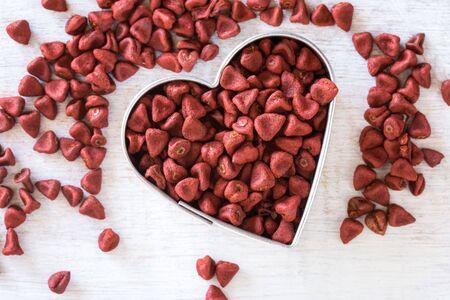 Achiote Seeds in Heart Shape Banco de Imagens