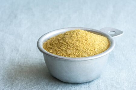 Nutritional Yeast in a Measuring Cup