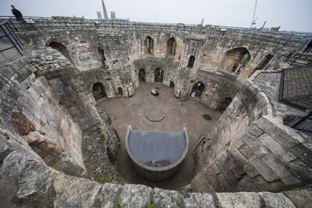 Top view from the Cliffords Tower in York England on a cloudy day. Heritage landmark.