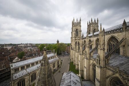 View from the York Minster Cathedral Tower into the city of York, England. Cloudy day. 스톡 콘텐츠