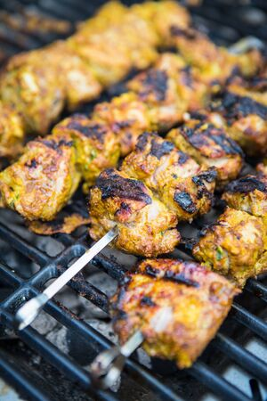 Close up of lamb tikka barbeque.BBQ lamb meat skewers on grill. Charring.